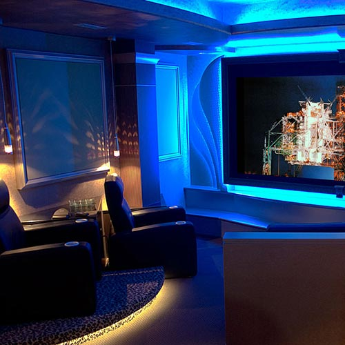 Home Theater Interior Design: David Hawkins Design Management, Inc. Multi-Family